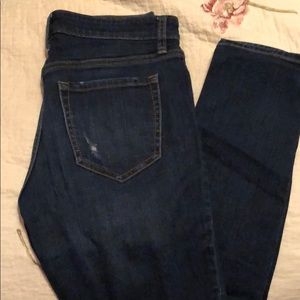 Distressed medium wash jeans